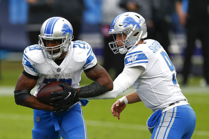 Detroit Lions quarterback Matthew Stafford hands off to the running back Adrian Peterson during the first half of an NFL football game Sunday, Dec. 20, 2020, in Nashville, Tenn. (AP Photo/Wade Payne)