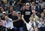 A team attendant and fans watch as a bat moves through AT&T Center during the first half of an NBA basketball game between the San Antonio Spurs and the New Orleans Pelicans in San Antonio, Saturday, Feb. 2, 2019. (AP Photo/Eric Gay)