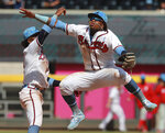 Atlanta Braves' Ronald Acuna Jr., right, and Ozzie Albies celebrate a victory over the Philadelphia Phillies in a baseball game Sunday, June 16, 2019, in Atlanta. (Curtis Compton/Atlanta Journal-Constitution via AP)