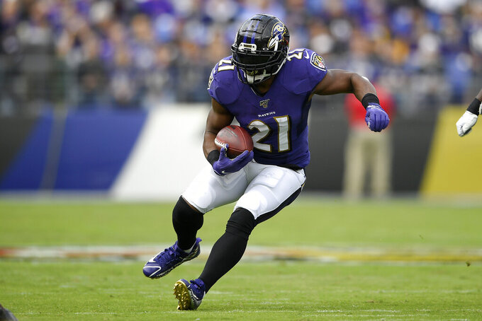 Baltimore Ravens running back Mark Ingram runs with the ball against the Cincinnati Bengals during the first half of a NFL football game Sunday, Oct. 13, 2019, in Baltimore. (AP Photo/Nick Wass)