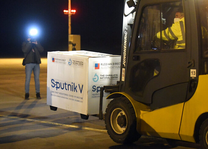 FILE - In this March 1, 2021, file photo, Russia's Sputnik V coronavirus vaccine arrives at Kosice Airport, Slovakia. Russia's boast in August that it was the first country to authorize a coronavirus vaccine led to skepticism because of its insufficient testing on only a few dozen people. Now, with demand growing for the Sputnik V, experts are raising questions again, this time over whether Moscow can keep up with all the orders from countries that want it. (Frantisek Ivan/TASR via AP, File)