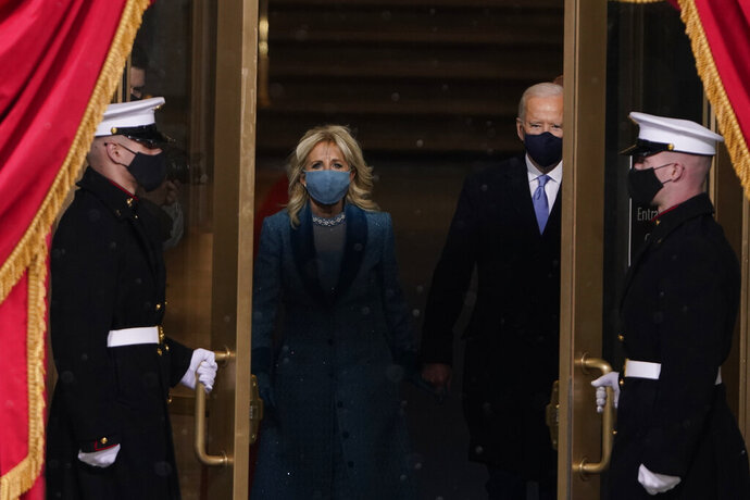 President-elect Joe Biden and his wife Jill, walk out for the 59th Presidential Inauguration at the U.S. Capitol in Washington, Wednesday, Jan. 20, 2021. (AP Photo/Patrick Semansky, Pool)