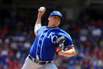 Kansas City Royals' Brad Keller throws to the Texas Rangers in the first inning of a baseball game in Arlington, Texas, Sunday, June 2, 2019. (AP Photo/Tony Gutierrez)