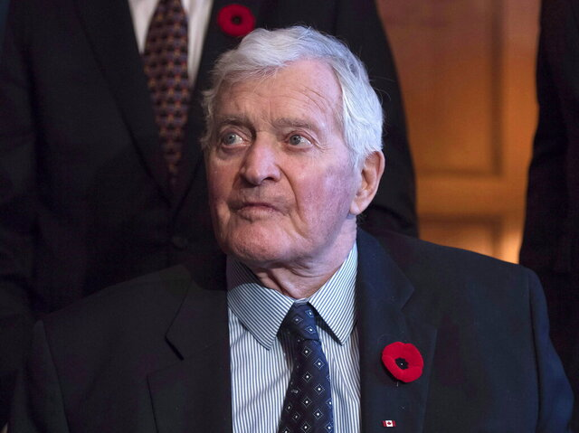 FILE - In this Nov. 6, 2017 file photo, former prime minister John Turner looks on during a photo op to mark the 150th anniversary of the first meeting of the first Parliament of Canada, in Ottawa.  Turner, whose odyssey from a