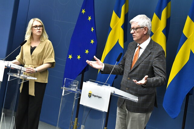 Lena Hallengren Minister for Health and Social Affairs, left, and Johan Carlson, Director General for the Swedish Public Health Agency, hold a news conference on Tuesday, May 26, 2020, about restrictions for vulnerable citizens over 70-years old in Stockholm, Sweden, Tuesday May 26, 2020.  (Claudio Bresciani / TT via AP)