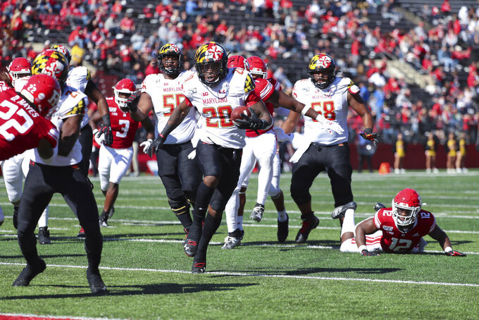 Maryland running back Javon Leake (20) carries the ball into the end zone for a 12-yard touchdown against Rutgers during the third quarter of an NCAA college football game, Saturday Oct. 5, 2019, in Piscataway, N.J. (Andrew Mills/NJ Advance Media via AP)