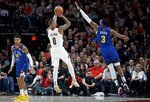 Portland Trail Blazers guard Damian Lillard, center, shoots over Denver Nuggets forward Torrey Craig during the first half of Game 3 of an NBA basketball second-round playoff series Friday, May 3, 2019, in Portland, Ore. (AP Photo/Craig Mitchelldyer)