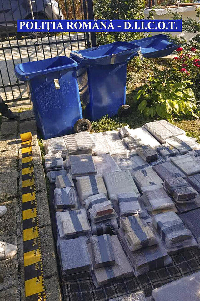 In this undated image provided by the Romanian Police a view of some 200 rare and valuable books discovered Wednesday, Sept. 16, 2020 hidden under a house in rural Romania, displayed in a garden in north eastern Romania. Romanian police have uncovered a trove of