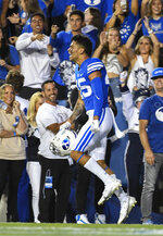 Brigham Young wide receiver Samson Nacua (45) celebrates after scoring a touchdown during the first half of an NCAA college football game against Utah Saturday, Sept. 11, 2021, in Provo, Utah. (AP Photo/Alex Goodlett)
