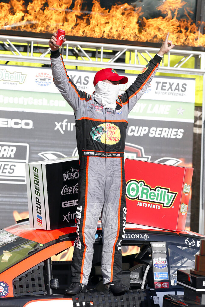 Austin Dillon stands on his car window in Victory Lane after winning the NASCAR Cup Series auto race at Texas Motor Speedway in Fort Worth, Texas, Sunday, July 19, 2020. (AP Photo/Ray Carlin)