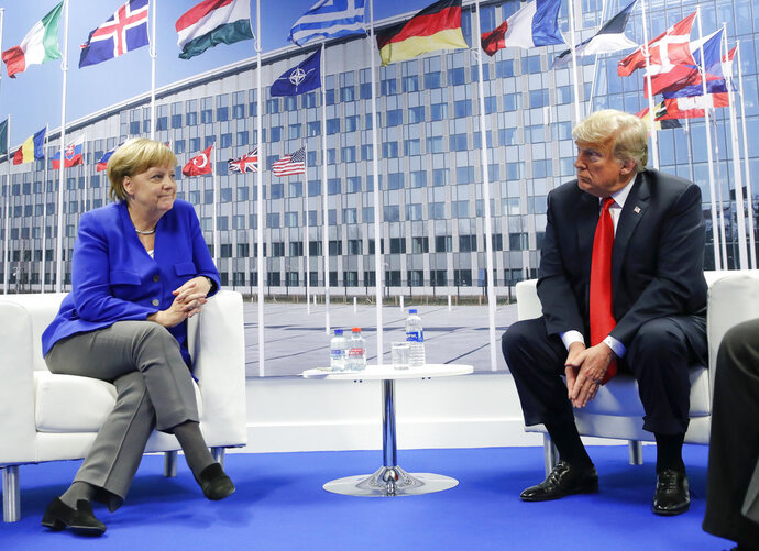 President Donald Trump and German Chancellor Angela Merkel during their bilateral meeting, Wednesday, July 11, 2018 in Brussels, Belgium. (AP Photo/Pablo Martinez Monsivais)