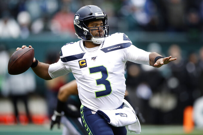 Seattle Seahawks' Russell Wilson passes during the first half of an NFL football game against the Philadelphia Eagles, Sunday, Nov. 24, 2019, in Philadelphia. (AP Photo/Matt Rourke)