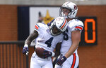 Auburn running back Tank Bigsby (4) celebrates a touchdown with teammate Luke Deal (86) during the A-Day spring football game Saturday, April 17, 2021, at Jordan-Hare Stadium in Auburn, Ala. (AP Photo/Julie Bennett)