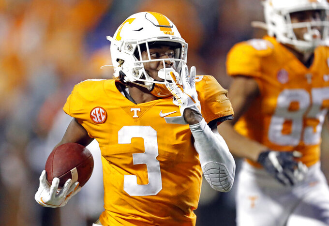 Tennessee running back Eric Gray (3) runs for a 94-yard touchdown in the first half of an NCAA college football game against Vanderbilt Saturday, Nov. 30, 2019, in Knoxville, Tenn. (AP Photo/Wade Payne)
