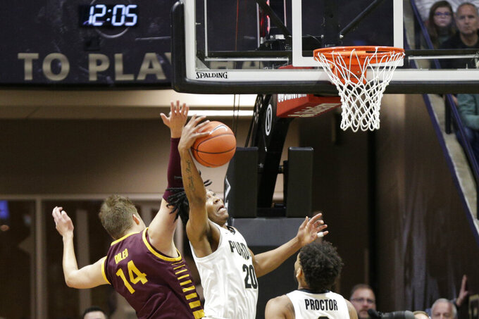 Purdue guard Nojel Eastern (20) gets the rebound against Central Michigan forward David DiLeo (14) during the first half of an NCAA college basketball game in West Lafayette, Ind., Saturday, Dec. 28, 2019. (Nikos Frazier/Journal & Courier via AP)