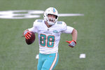 Miami Dolphins' Mike Gesicki celebrates his touchdown during the first half of an NFL football game against the New York Jets, Sunday, Nov. 29, 2020, in East Rutherford, N.J. (AP Photo/Bill Kostroun)
