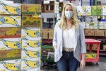 MANNA FoodBank CEO Hanna Randall is photographed at the nonprofit's warehouse on Swannanoa River Road in Asheville, N.C., on Wednesday, May 5, 2021. The nonprofit and its partner agencies last March served 128,690 people in Western North Carolina, a 93% jump from February to the onset of the pandemic. (Angela Wilhelm /The Asheville Citizen-Times via AP)