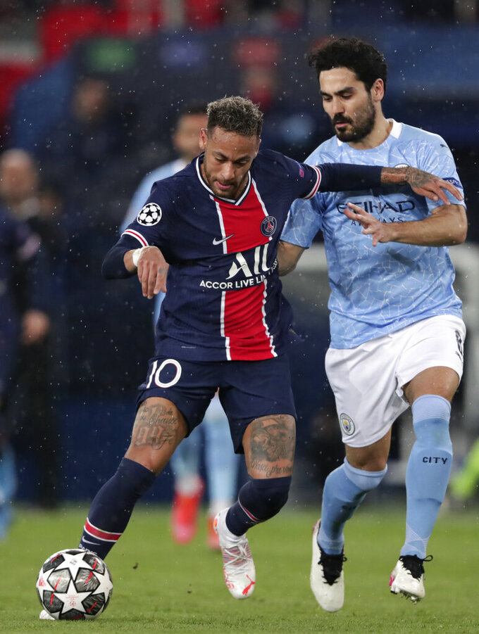 Manchester City's Ilkay Gundogan, right, challenges PSG's Neymar during the Champions League semifinal first leg soccer match between Paris Saint Germain and Manchester City at the Parc des Princes stadium, in Paris, France , Wednesday, April 28, 2021. (AP Photo/Thibault Camus)