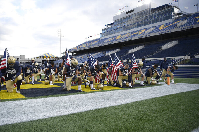 Navy pauses in the end zone before an NCAA college football game against Tulsa, Saturday, Dec. 5, 2020, in Annapolis, Md. (AP Photo/Nick Wass)