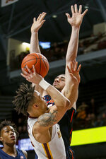 Minnesota's Amir Coffey (5) shoots against Illinois' Giorgi Bezhanishvili (15) during the first half of an NCAA college basketball game Wednesday, Jan. 30, 2019, in Minneapolis. (AP Photo/Bruce Kluckhohn)