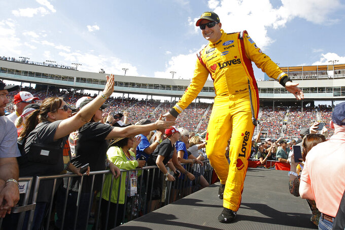 Michael McDowell greets fans during driver introductions prior to the NASCAR Cup Series auto race at ISM Raceway, Sunday, Nov. 10, 2019, in Avondale, Ariz. (AP Photo/Ralph Freso)