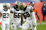 New Orleans Saints outside linebacker Demario Davis (56) and outside linebacker Kwon Alexander (58) celebrates a defensive stop against the Denver Broncos during the second half of an NFL football game, Sunday, Nov. 29, 2020, in Denver. (AP Photo/Jack Dempsey)