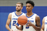 In this Oct. 16, 2019, photo, Ty-Shon Alexander (5) and Mitch Ballock (24) watch during Creighton's NCAA college basketball media day in Omaha, Neb. A strong finish to last year's regular season could not push Creighton into the NCAA Tournament. The Bluejays are using the disappointment for motivation. Preseason All-Big East pick Alexander is among four returning starters from the team that finished 20-15 overall, tied for third in the Big East and reached the NIT quarterfinals. Marcus Zegarowski, Davion Mintz and Ballock also are back. The Bluejays open Nov. 5 at home against Kennesaw State. (AP Photo/Nati Harnik)