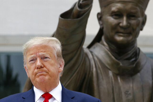 President Donald Trump visits Saint John Paul II National Shrine with first lady Melania Trump, Tuesday, June 2, 2020, in Washington. (AP Photo/Patrick Semansky)