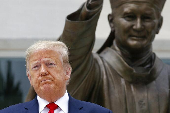 President Donald Trump visits Saint John Paul II National Shrine with first lady Melania Trump, Tuesday, June 2, 2020, in Washington. (AP Photo/Patrick Semansky)