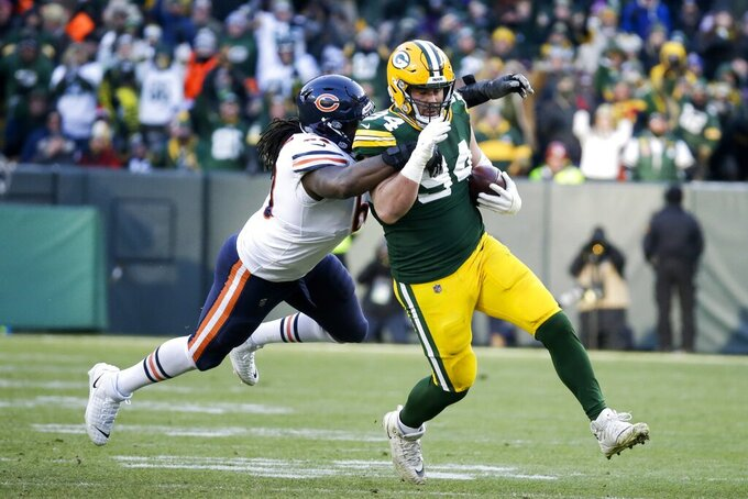 Green Bay Packers' Dean Lowry intercepts a pass during the second half of an NFL football game against the Chicago Bears Sunday, Dec. 15, 2019, in Green Bay, Wis. (AP Photo/Mike Roemer)