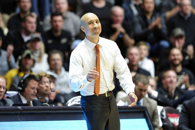 Texas head coach Shaka Smart reacts to a call on the court as his team played Purdue in the second half of an NCAA college basketball game in West Lafayette, Ind., Saturday, Nov. 9, 2019. Texas won 70-66. (AP Photo/AJ Mast)