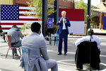 FILE - In this Sept. 23, 2020, file photo, Democratic presidential candidate former Vice President Joe Biden speaks during a Biden for President Black economic summit at Camp North End in Charlotte, N.C. Following an unprecedented surge of protests against racial injustice and the killing of Black people by law enforcement, partisan and nonpartisan organizations have poured significant resources into increasing Black men's participation in the election.  (AP Photo/Carolyn Kaster)