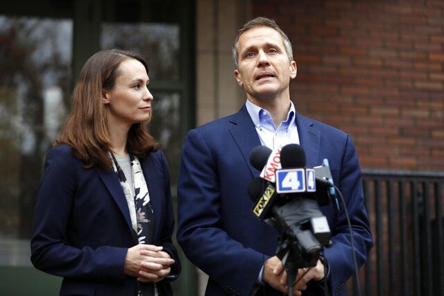 This Dec. 6, 2016 photo, Missouri Gov.-elect Eric Greitens and his wife Sheena speak to the media in St. Louis.  The former Missouri Govorner and his wife Sheena are divorcing, the couple announced on social media Saturday, April 11 2020, nearly two years after Greitens resigned amid accusations that he took a compromising photo of a woman without her consent during a 2015 extramarital affair. (AP Photo/Jeff Roberson, File)