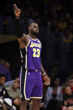 Los Angeles Lakers' LeBron James (23) signals during the first half of the team's NBA basketball game against the Miami Heat on Friday, Nov. 8, 2019, in Los Angeles. (AP Photo/Marcio Jose Sanchez)