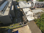 An aerial view looks over the Flamengo soccer club training complex where an early morning fire left a number of people dead and injured in Rio de Janeiro, Brazil, Friday, Feb. 8, 2019. (AP Photo/Renato Spyrro)