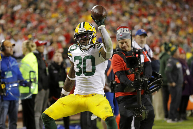 Green Bay Packers running back Jamaal Williams (30) celebrates a touchdown off a throw by quarterback Aaron Rodgers during the second half of an NFL football game against the Kansas City Chiefs in Kansas City, Mo., Sunday, Oct. 27, 2019. (AP Photo/Charlie Riedel)