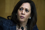 "FILE - In this Thursday, June 25, 2020 file photo, Sen. Kamala Harris, D-Calif., attends a Senate Homeland Security and Governmental Affairs Committee hearing on Capitol Hill in Washington. On Friday, July 3, 2020, The Associated Press reported on stories circulating online incorrectly asserting Harris said on June 18 that once President Trump is no longer in office ""and we have regained our rightful place in the White House,"" his supporters will feel the ""vengeance of a nation."" This fabricated quote originated in the satirical website Bustatroll.org in 2019 and is making the rounds again — but this time, people are sharing it as true. (Tom Williams/Pool via AP)"