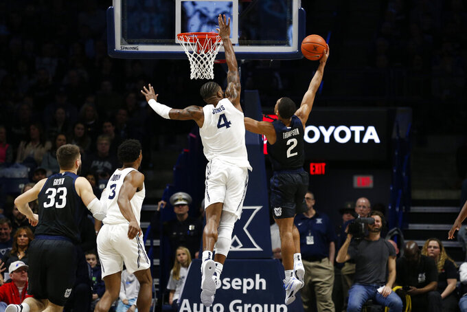 Butler guard Aaron Thompson (2) shoots over Xavier forward Tyrique Jones (4) during the first half of an NCAA college basketball game Saturday, March 7, 2020, in Cincinnati. (AP Photo/Gary Landers)