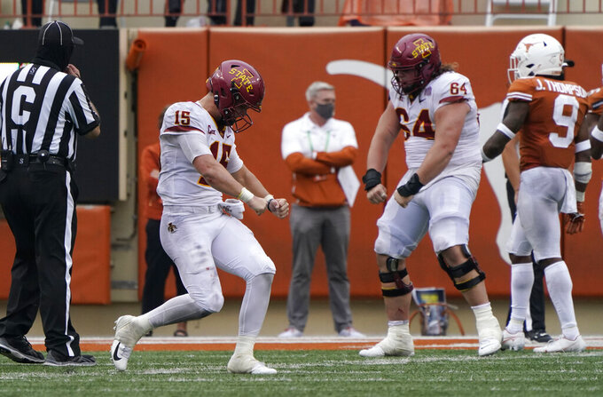 Iowa State quarterback Brock Purdy (15) and offensive lineman Derek Schweiger (64) celebrate a touchdown against Texas during the second half of an NCAA college football game, Friday, Nov. 27, 2020, in Austin, Texas. (AP Photo/Eric Gay)