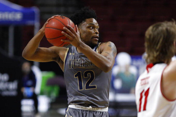 Montana State guard Mike Hood (12) looks to pass the ball during an NCAA college basketball game against Eastern Washington for the championship of the Big Sky men's tournament in Boise, Idaho, Saturday, March 13, 2021. Eastern Washington won 65-55. (AP Photo/Otto Kitsinger)