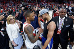 Golden State Warriors guard Stephen Curry, right, and Portland Trail Blazers guard Damian Lillard talk at the end of Game 4 of the NBA basketball playoffs Western Conference finals Monday, May 20, 2019, in Portland, Ore. The Warriors won 119-117 in overtime. (AP Photo/Craig Mitchelldyer)