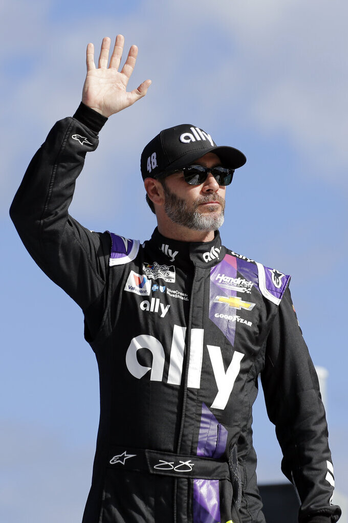 Jimmie Johnson waves to fans during introductions for the NASCAR Busch Clash auto race at Daytona International Speedway, Sunday, Feb. 9, 2020, in Daytona Beach, Fla. (AP Photo/Terry Renna)