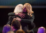 Laura Dern, right, hugs Bruce Dern before going on stage to accept the award for outstanding performance by a female actor in a supporting role for