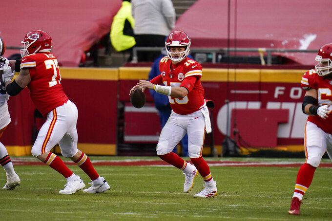 Kansas City Chiefs quarterback Patrick Mahomes (15) looks to pass during the second half of an NFL divisional round football game against the Cleveland Browns, Sunday, Jan. 17, 2021, in Kansas City. (AP Photo/Jeff Roberson)