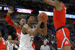 Michigan State's Xavier Tillman (23) takes a shot against Ohio State's Musa Jallow, right, and Ohio State's Kaleb Wesson (34) during the first half of an NCAA college basketball game in the quarterfinals of the Big Ten Conference tournament, Friday, March 15, 2019, in Chicago. (AP Photo/Kiichiro Sato)