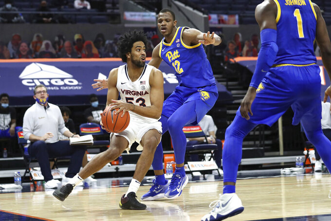 Pittsburgh forward Abdoul Karim Coulibaly (12) guards against Virginia guard Tomas Woldetensae (53) during an NCAA college basketball game Saturday, Feb. 6, 2021, in Charlottesville, Va. (Erin Edgerton/The Daily Progress via AP, Pool)
