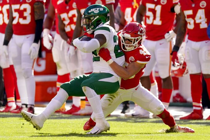 New York Jets running back La'Mical Perine (22) is tackled by Kansas City Chiefs safety Daniel Sorensen (49) after a short gain in the first half of an NFL football game on Sunday, Nov. 1, 2020, in Kansas City, Mo. (AP Photo/Charlie Riedel)