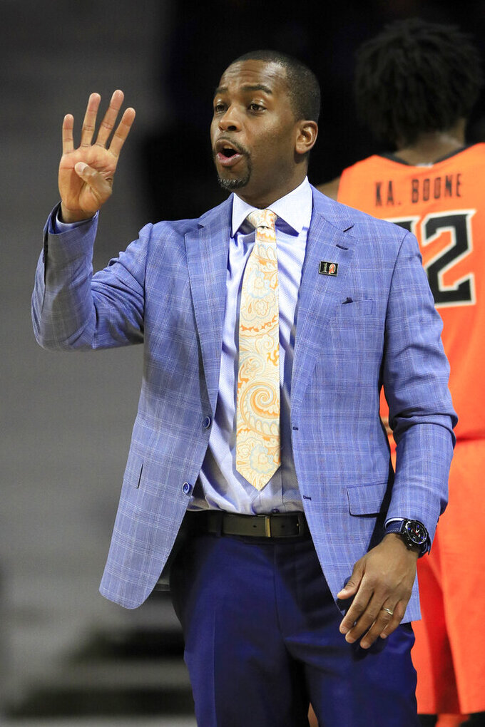 Oklahoma State head coach Mike Boynton call a play during the first half of an NCAA college basketball game against Kansas State in Manhattan, Kan., Tuesday, Feb. 11, 2020. (AP Photo/Orlin Wagner)
