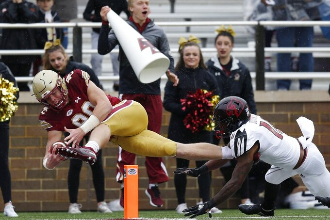 Boston College tight end Hunter Long (80) extends for a touchdown against Louisville cornerback Rodjay Burns (10) during the first half of an NCAA college football game in Boston, Saturday, Oct. 13, 2018. (AP Photo/Michael Dwyer)