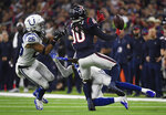 Indianapolis Colts cornerback Pierre Desir (35) and strong safety Clayton Geathers (26) break up a pass intended for Houston Texans wide receiver DeAndre Hopkins (10) during the second half of an NFL wild card playoff football game, Saturday, Jan. 5, 2019, in Houston. (AP Photo/Eric Christian Smith)